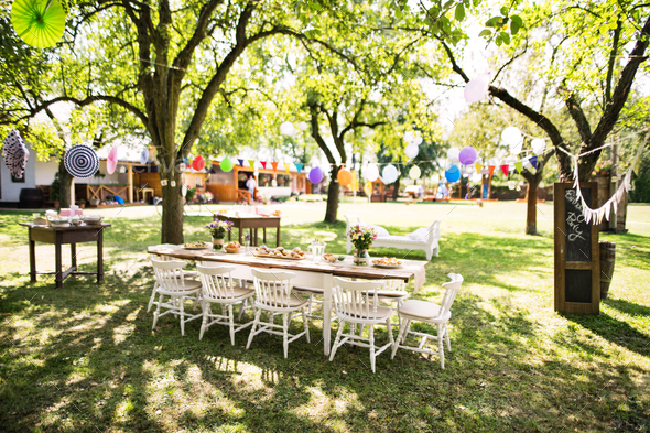 Table set for a garden party or celebration outside. - Stock Photo - Images