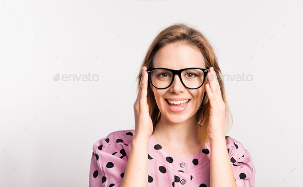 Portrait of a young beautiful woman in studio on a white background. - Stock Photo - Images