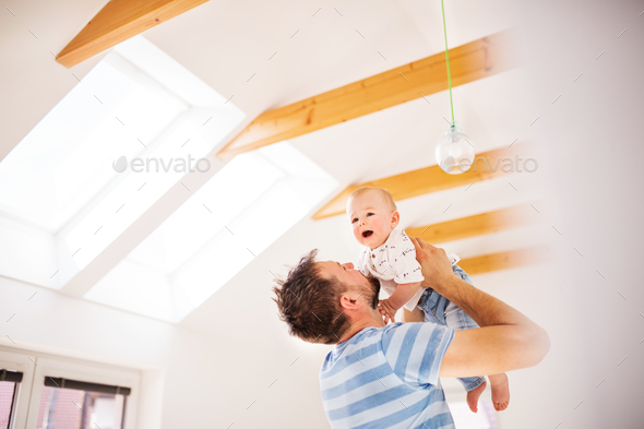 Young father with a baby son at home, having fun. - Stock Photo - Images