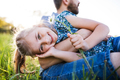 Father with a small daughter having fun in spring nature. - PhotoDune Item for Sale