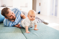 Young father with a baby son at home, having fun. - PhotoDune Item for Sale