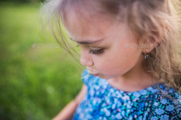 A small girl in the garden in spring nature. Copy space. - Stock Photo - Images