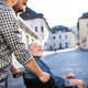 An adult son with senior father in wheelchair on a walk in town. - PhotoDune Item for Sale