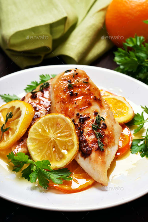 Roasted chicken breast in orange sauce - Stock Photo - Images
