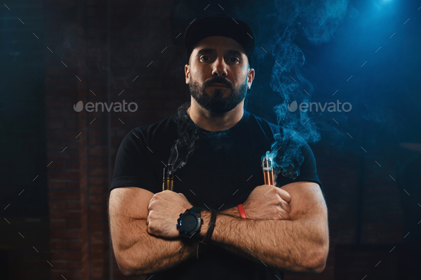 Man vaping an electronic cigarette - Stock Photo - Images