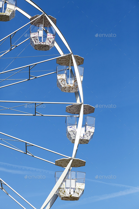 Ferris wheel against the blue sky. - Stock Photo - Images