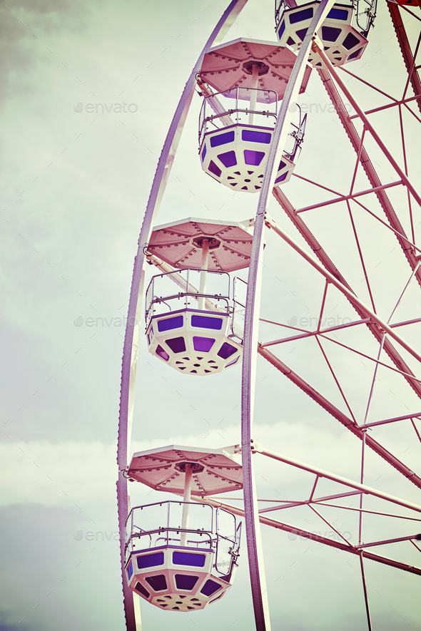 Retro toned picture of Ferris wheel cars - Stock Photo - Images