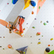 Young woman bouldering challenging route in climbing gym - PhotoDune Item for Sale