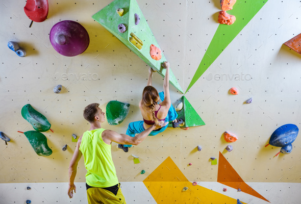 Rock climbers in climbing gym.  - Stock Photo - Images