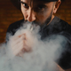Man vaping an electronic cigarette - PhotoDune Item for Sale