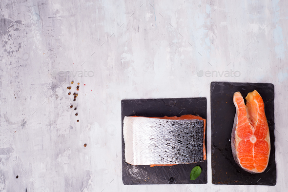 pieces of salmon fillet on dark slate cutting board. Lean proteins. - Stock Photo - Images