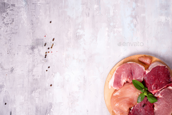 Different types of meat on a wooden board. Lean proteins. - Stock Photo - Images