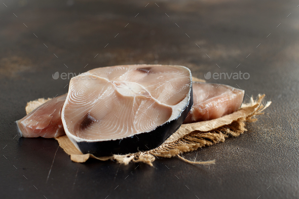 Two shark steak on a dark board - Stock Photo - Images