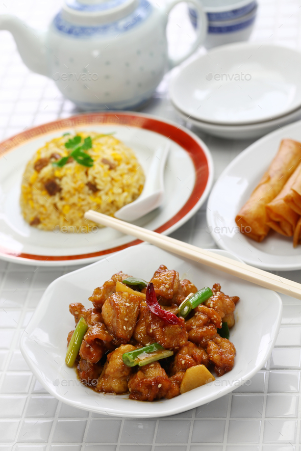 general tso's chicken, fried rice, spring rolls, american chinese cuisine - Stock Photo - Images