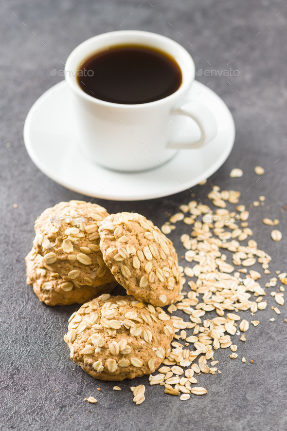 Healthy oatmeal cookies and cup of coffee. - Stock Photo - Images