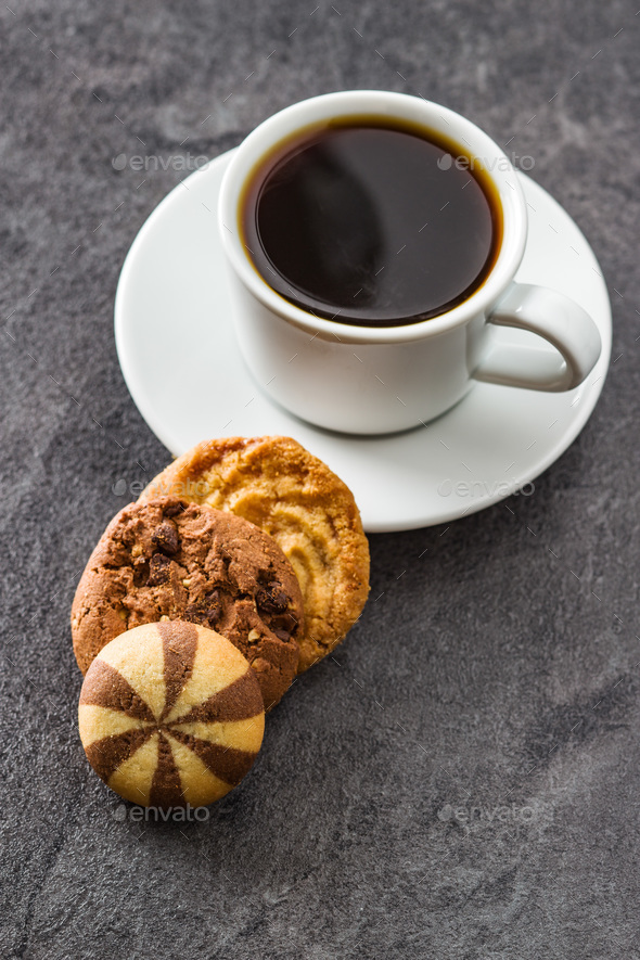 Cup of coffee and sweet cookies. - Stock Photo - Images