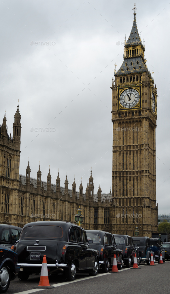 Big Ben and London taxi cabs - Stock Photo - Images