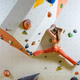 Young woman climbing challenging bouldering route. In climbing gym. - PhotoDune Item for Sale