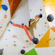 Young woman climbing challenging bouldering route - PhotoDune Item for Sale