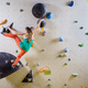 Young woman climbing bouldering route - PhotoDune Item for Sale