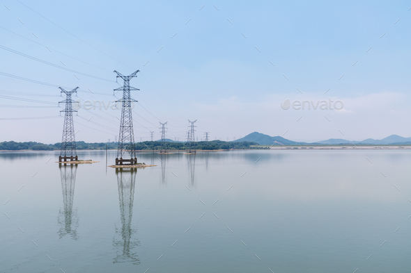 power transmission tower and reflection on lake - Stock Photo - Images