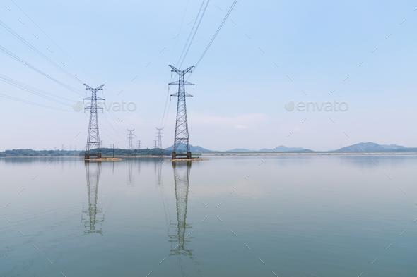electricity pylon on lake - Stock Photo - Images