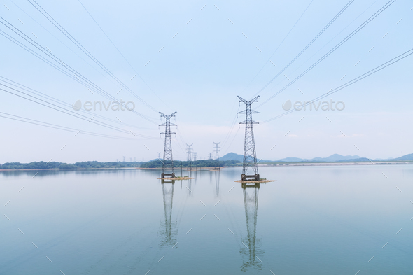 power transmission tower on water - Stock Photo - Images