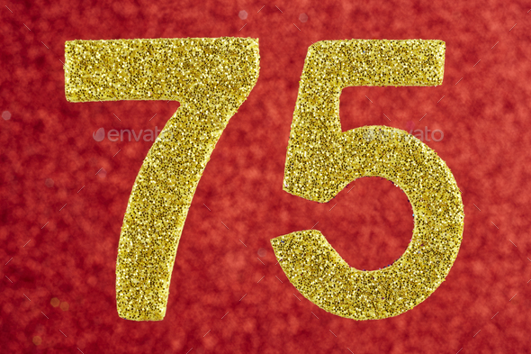 Number seventy-five golden color over a red background. Anniversary. Birthday - Stock Photo - Images