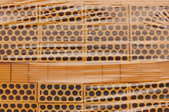 Packed new construction orange bricks. Construction materials. Horizontal  - Stock Photo - Images