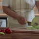 Hands of an Elderly Woman Cutting the Cabbage with a Knife on a Chopping Board - VideoHive Item for Sale