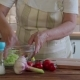 Elderly Woman Salting Cabbage at Home in the Kitchen - VideoHive Item for Sale