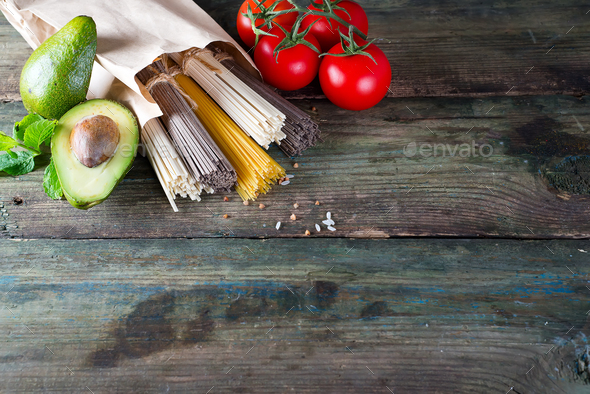 bunch of Italian spaghetti, noodles soba and sommel,  avocado with tomato - Stock Photo - Images
