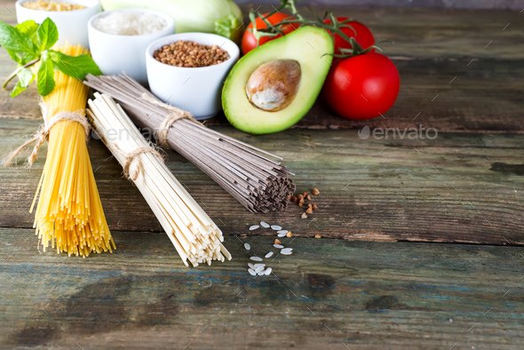 bunch of Italian spaghetti, noodles soba and sommel, avocado, zucchini with tomato - Stock Photo - Images