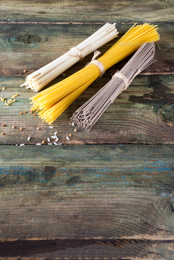 Noodles soba, somen and italian spaghetti on wooden background. Traditional Japanese food. - Stock Photo - Images
