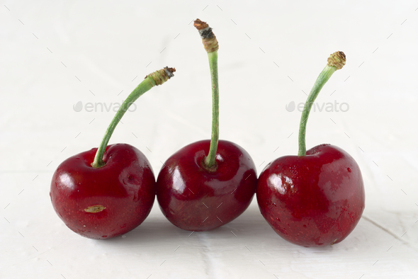 ripe cherries on white textured background - Stock Photo - Images