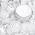 Close-up of open glass jar with cooling cream on crushed ice - PhotoDune Item for Sale