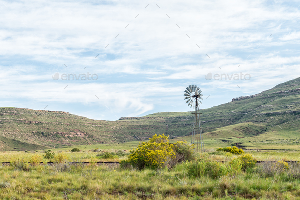 Water-pumping windmill and historic railway track near Lady Grey - Stock Photo - Images