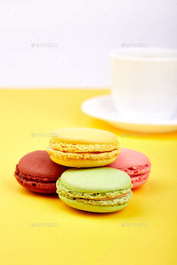 Sweet Dessert Macaron or macaroon with coffee - Stock Photo - Images