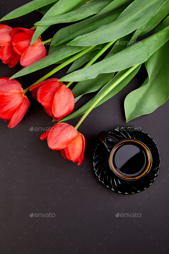 Bouquet red tulips and cup of coffee - Stock Photo - Images