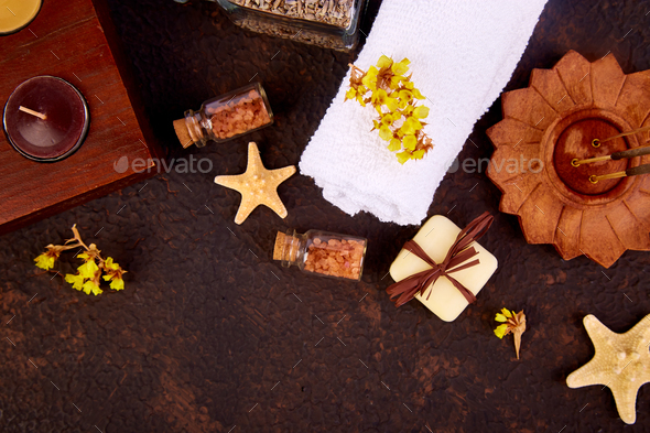 Spa concept. Aromatic candles, towel - Stock Photo - Images