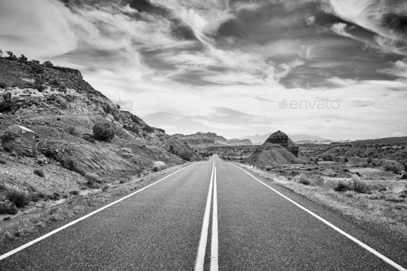 Black and white picture of a deserted road, USA. - Stock Photo - Images