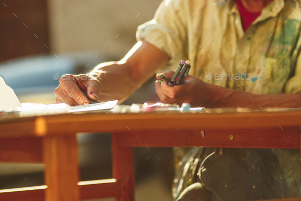 Close up man working of Architect sketching a construction project  - Stock Photo - Images