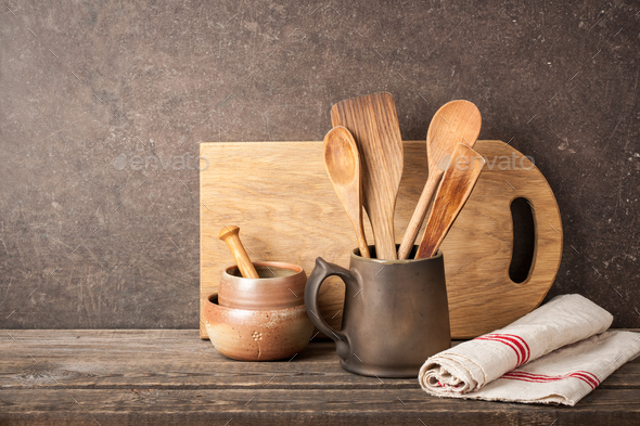 Kitchen utensils on wooden table - Stock Photo - Images