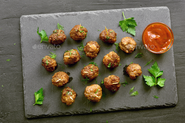 Delicious meatballs with tomato sauce - Stock Photo - Images