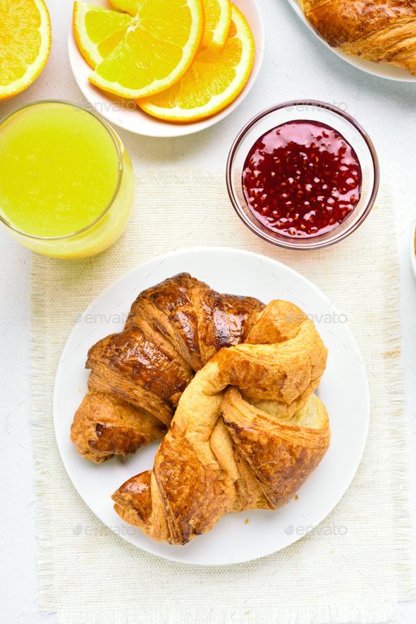 Breakfast with croissants, orange juice, raspberry jam - Stock Photo - Images