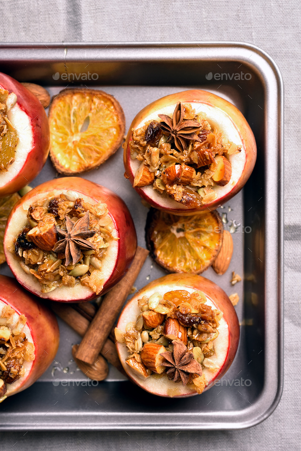 Baked apples with granola, cinnamon, nuts - Stock Photo - Images