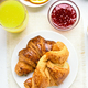 Breakfast with croissants, orange juice, raspberry jam - PhotoDune Item for Sale
