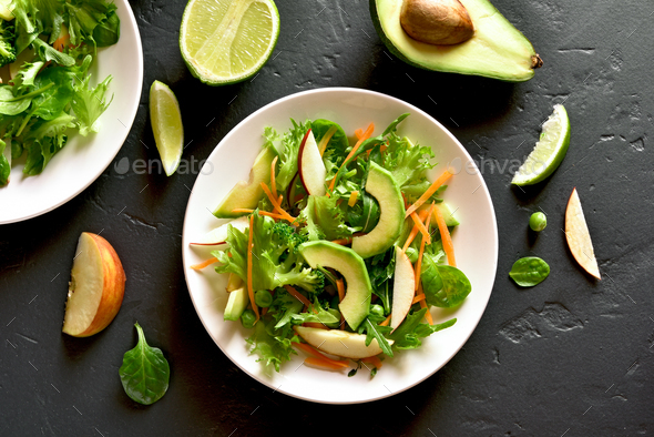 Salad with avocado, green pea, greens, apple - Stock Photo - Images