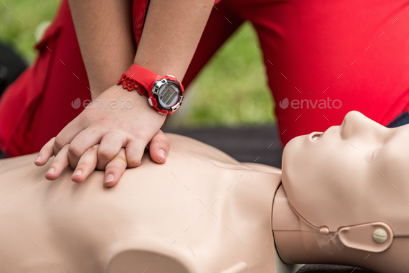 Cpr training outdoors. Reanimation procedure on CPR doll - Stock Photo - Images