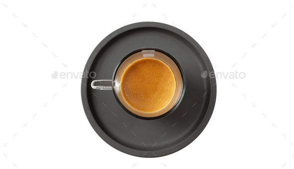 Espresso coffee on black saucer isolated on a white background, top view - Stock Photo - Images